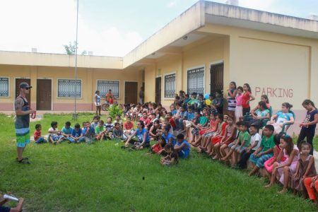 200 Village children gather to hear a story
