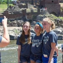 Students at the waterfall in Sioux Falls, SD