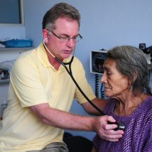 Doctor examining a patient in our clinic