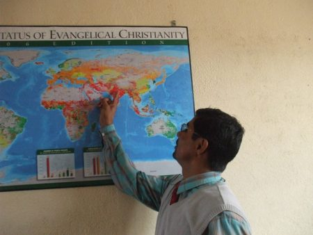 Barnabas pointing out Nepal on the world map