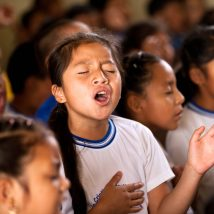 Girl worshiping in morning devotional