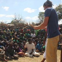 A short-term worker sharing the Gospel in a Malawian village