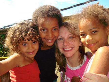 ACTION missionary from North Carolina with girls she ministers to in Brazil